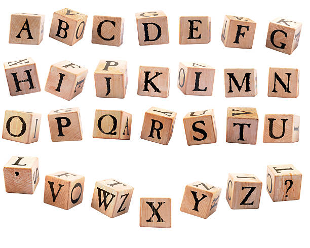 Alphabet Blocks #2 A complete set of rustic alphabet blocks A - Z plus an apostrophe and question mark.  They are oriented differently to appear as if they are falling.  Isolated on white.  (May be used to suppliment set #1 so repeat letters aren't duplicated blocks.) apostrophe stock pictures, royalty-free photos & images