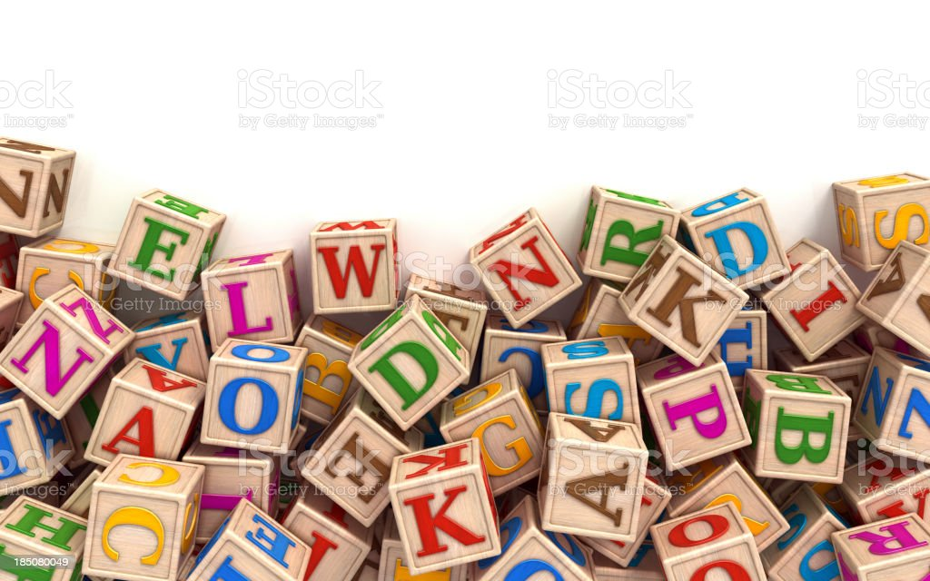 Alphabet blocks scattered at the bottom stock photo