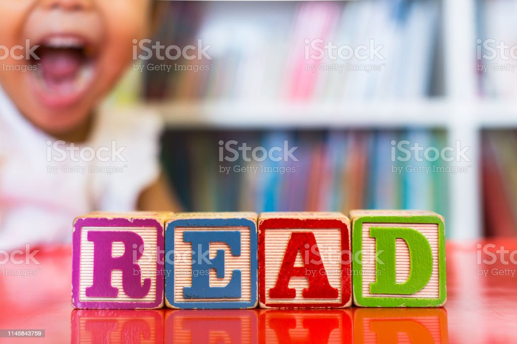 Closeup of kids alphabet wooden blocks arranged to spell \