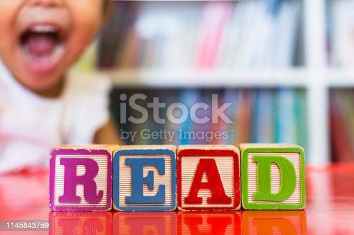 Closeup of kids alphabet wooden blocks arranged to spell