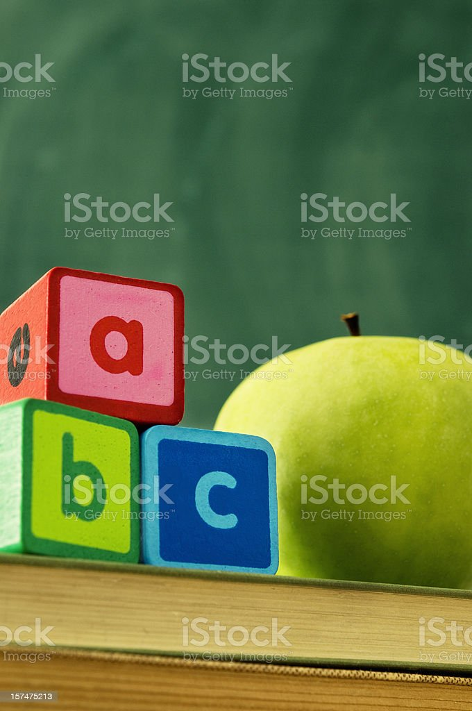 Alphabet blocks with apple royalty-free stock photo