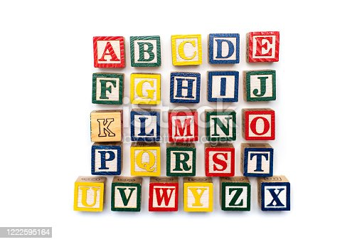 istock Alphabet characters written with wooden letters, education abstract background 1222595164