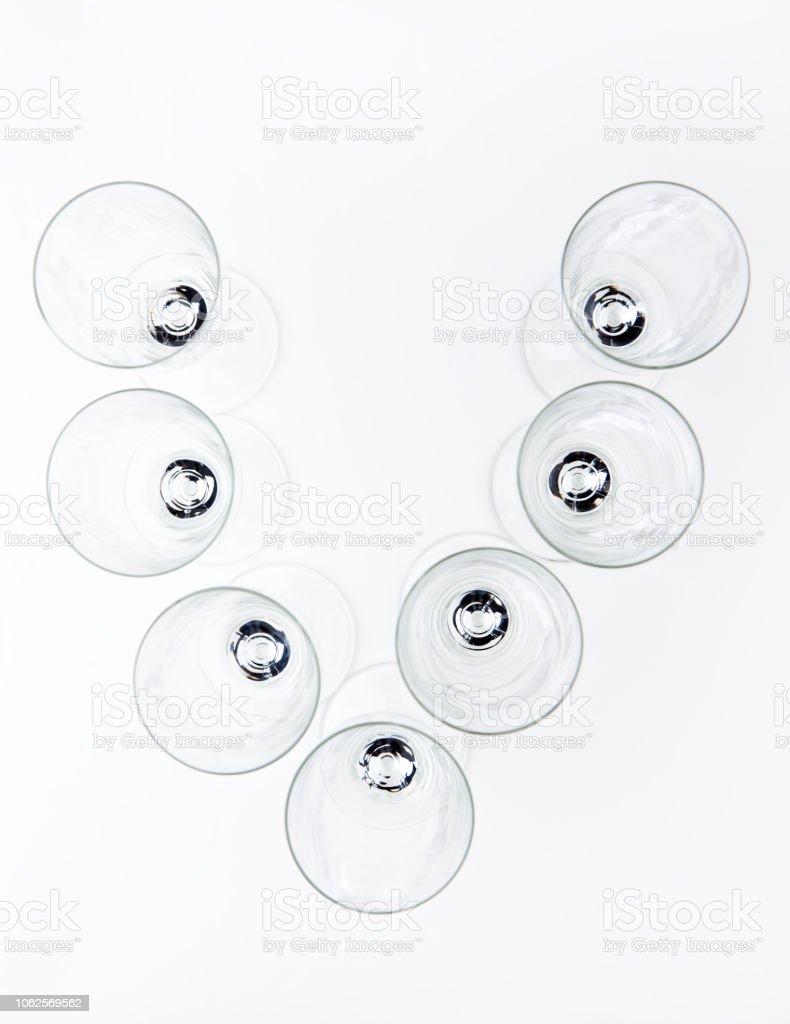 alphabet Empty champagne glass white background stock photo