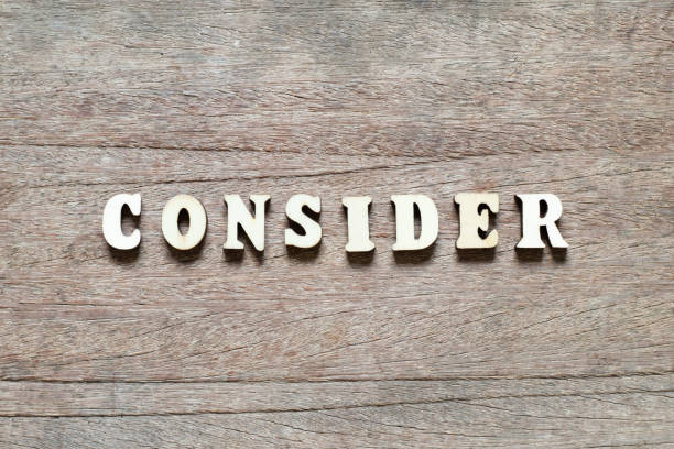 Alphabet letter block in word consider on wood background Alphabet letter block in word consider on wood background deem stock pictures, royalty-free photos & images