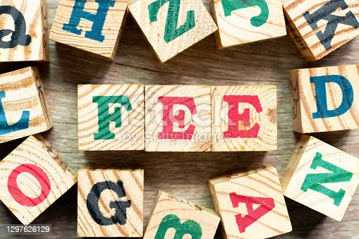 Alphabet letter block in word fee with another on wood background