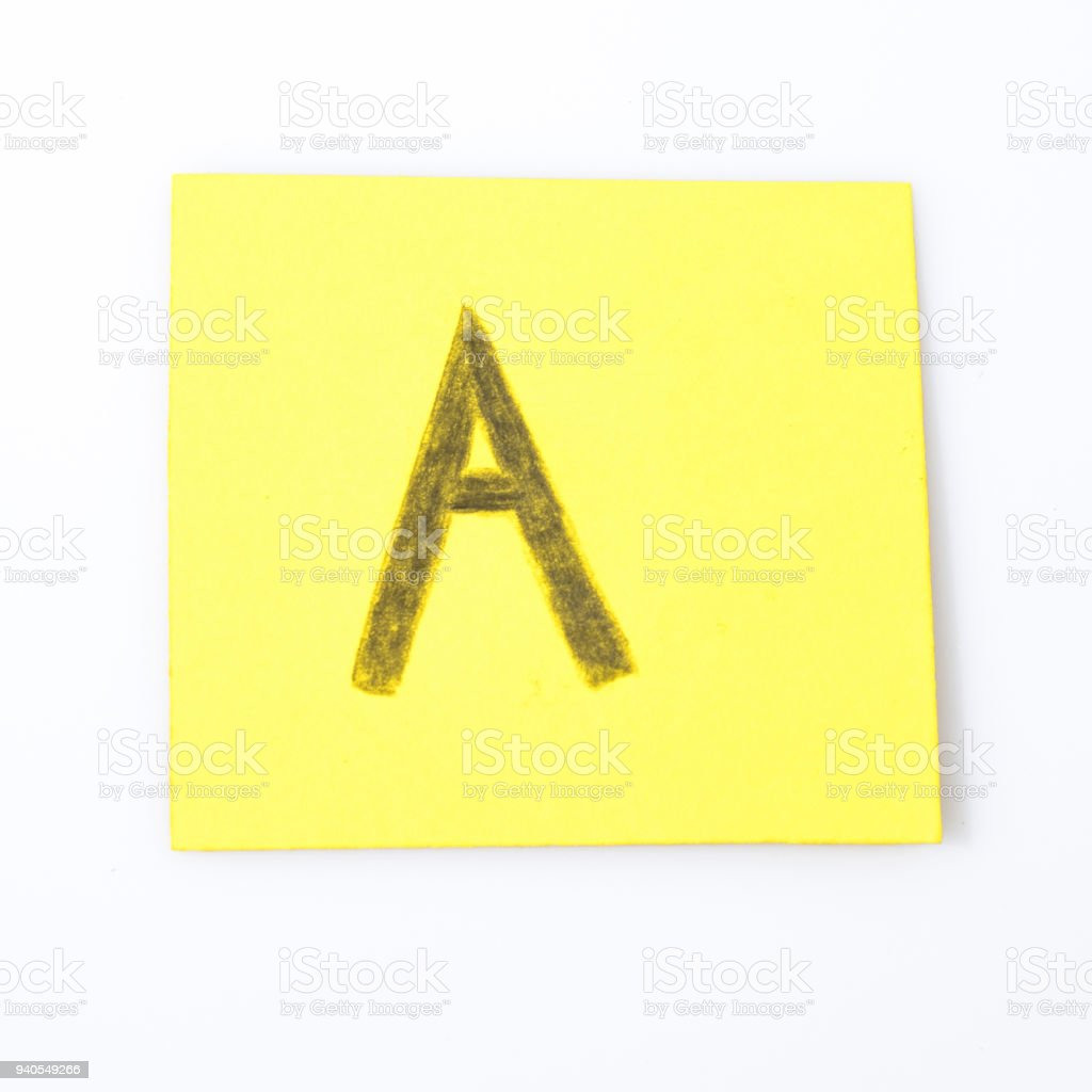 A alphabet letter handwrite on a yellow paper composition stock photo