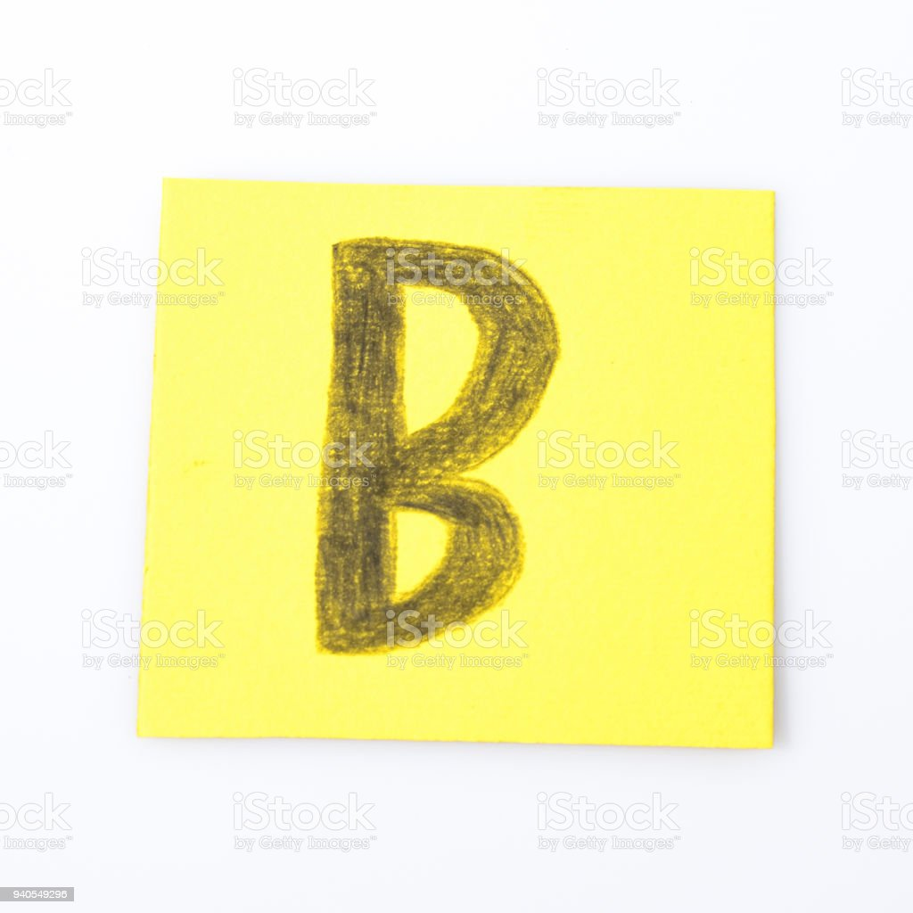 B alphabet letter handwrite on a yellow paper composition stock photo