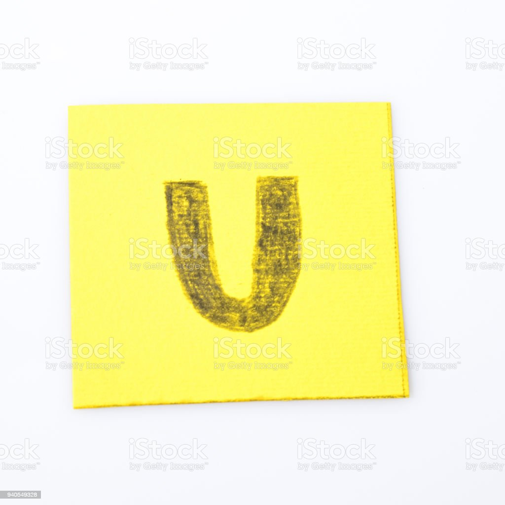 U alphabet letter handwrite on a yellow paper composition stock photo