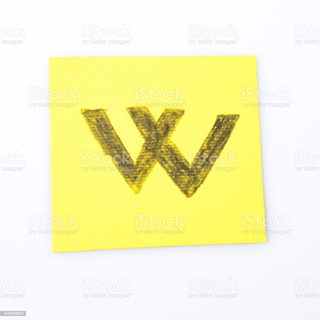 W alphabet letter handwrite on a yellow paper composition stock photo