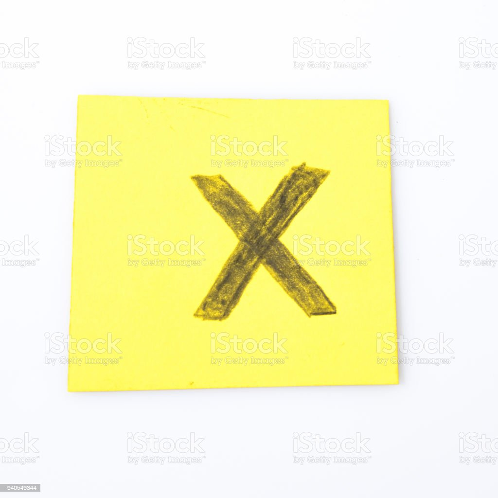 X alphabet letter handwrite on a yellow paper composition stock photo