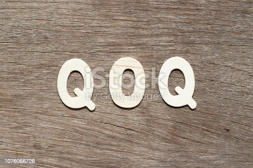 istock Alphabet letter in word QOQ (abbreviation of quarter on quarter) on wood background 1076066726
