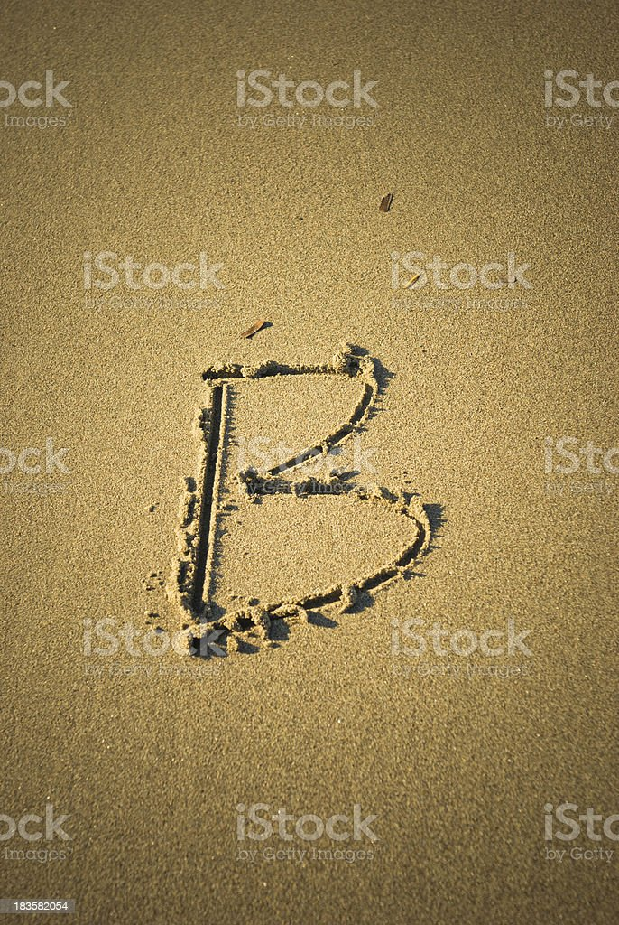 Alphabet letters B in the sand royalty-free stock photo