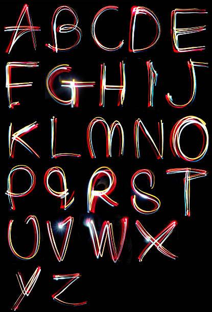 alphabet light neon writing long exposure - ruth 個照片及圖片檔