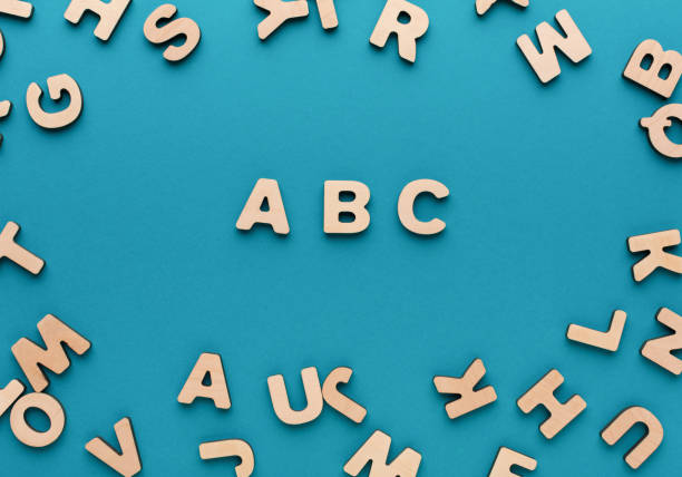 alphabet made of wooden letters - word game stock pictures, royalty-free photos & images