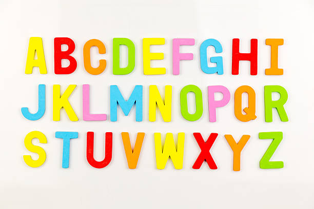 Alphabet magnets on whiteboard stock photo