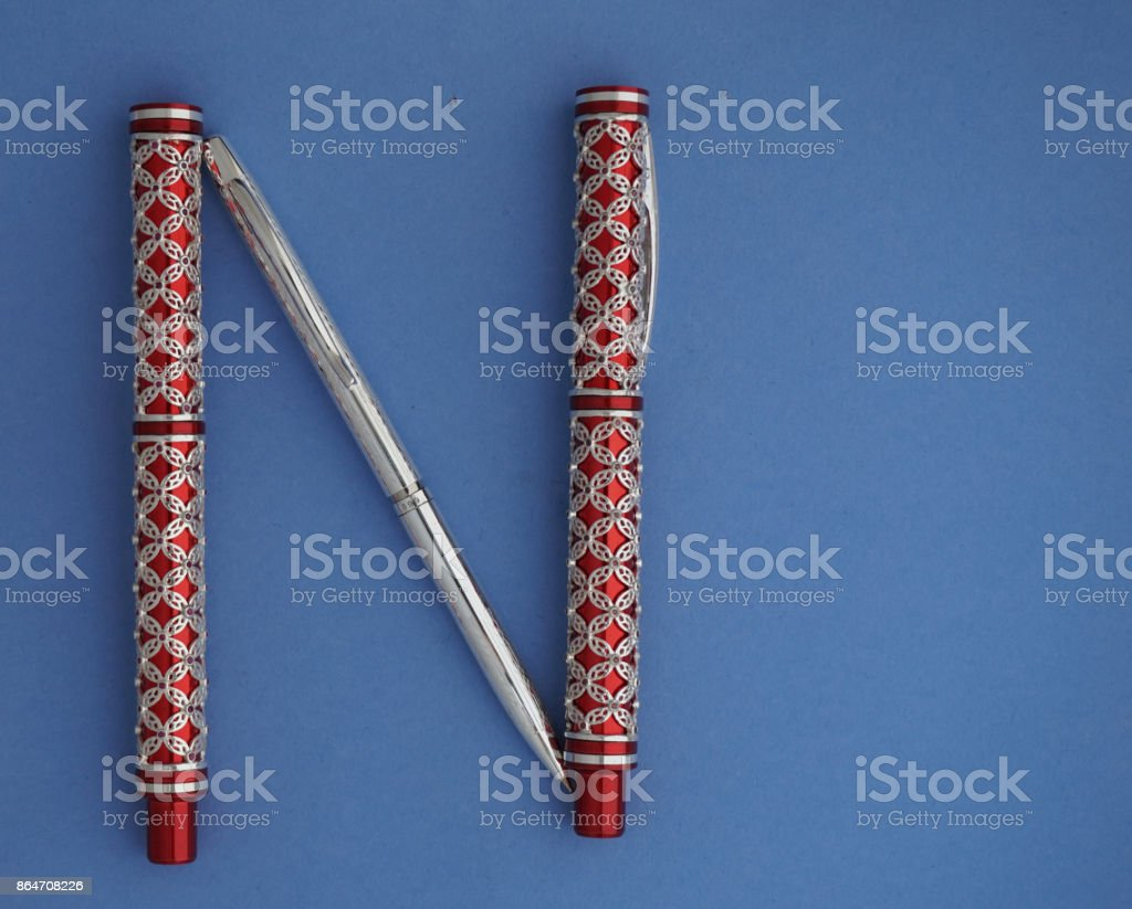 Alphabet 'N' in red and Silver pen stock photo