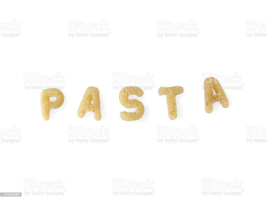 Alphabet noodles spelling 'pasta' on white background stock photo