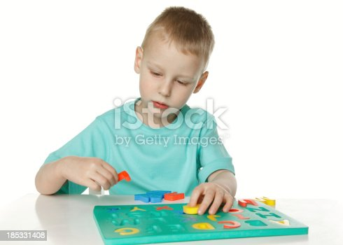 Little boy playing with alphabet.