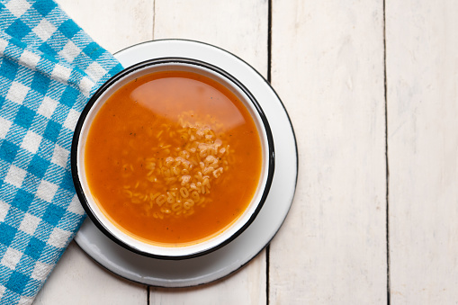 Alphabet soup pasta on white background
