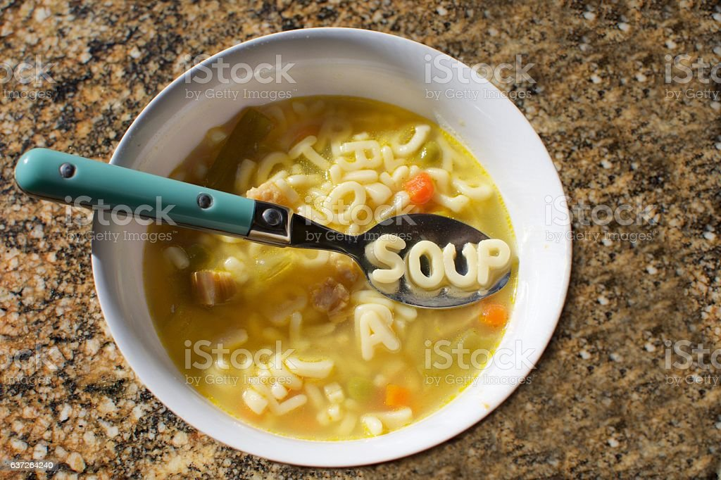 alphabet soup with the word soup spelled out on spoon – Foto