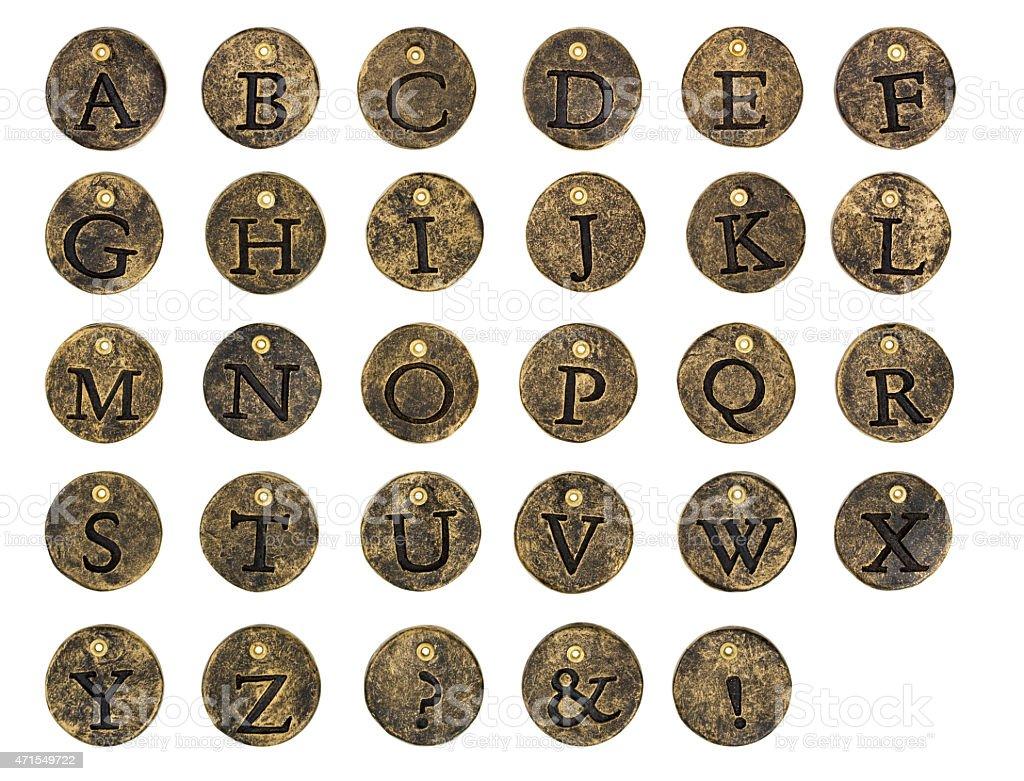 Alphabet Stone Button Charms stock photo