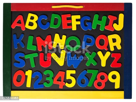 istock Alphabet Toy Magnetic Letters on Blackboard 505840083