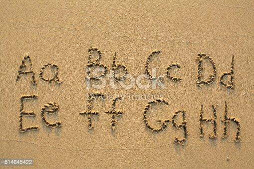 istock Alphabet written in light beach sand 514645422