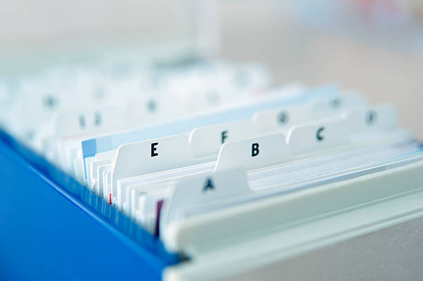 Alphabetical Index Cards Alphabetical Index Cards In File Cabinet telephone directory stock pictures, royalty-free photos & images