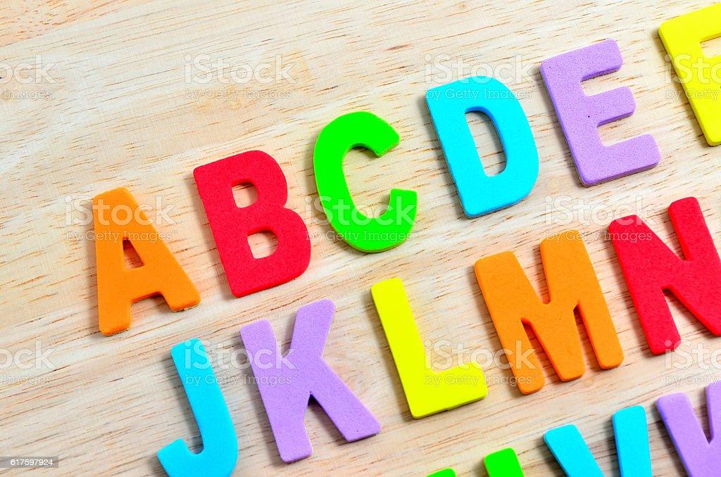 ABC alphabets on wooden background stock photo