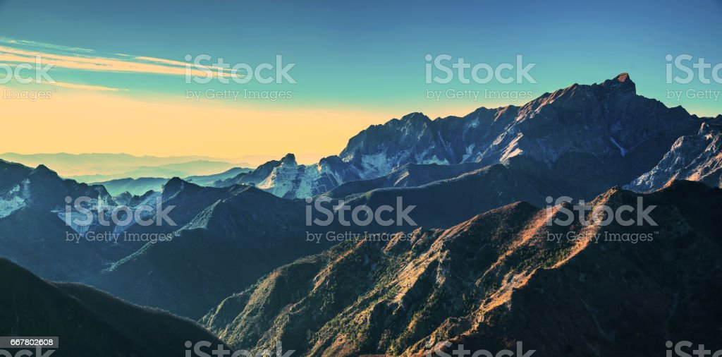 Alpi Apuane mountains and marble quarry view at sunset. Carrara, Tuscany, Italy. stock photo