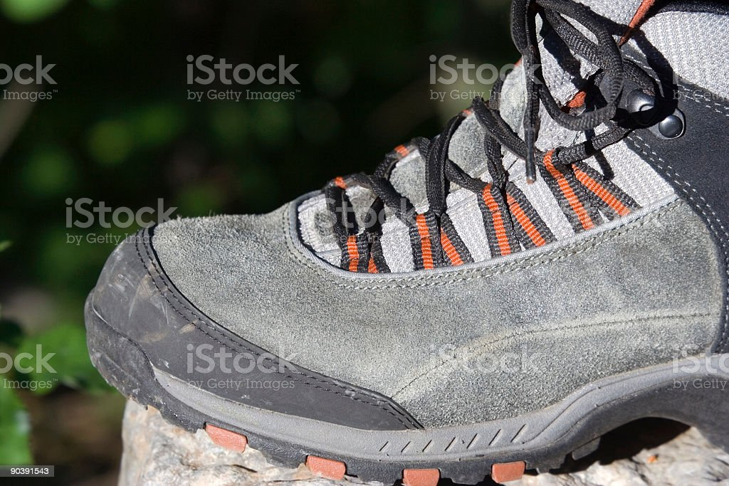 alpine boots on a rock stock photo