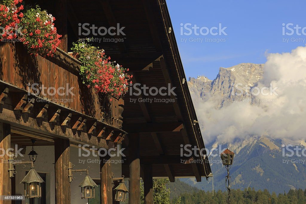 Alpine Chalet facing Zugspitze mountain stock photo