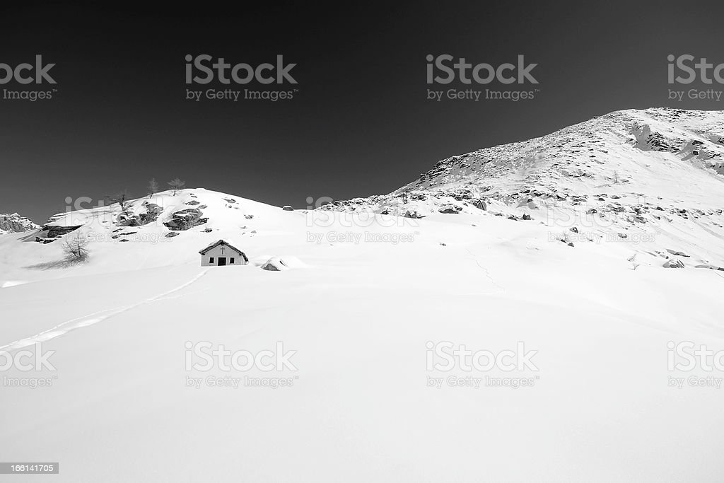 Alpine chapel in black and white royalty-free stock photo