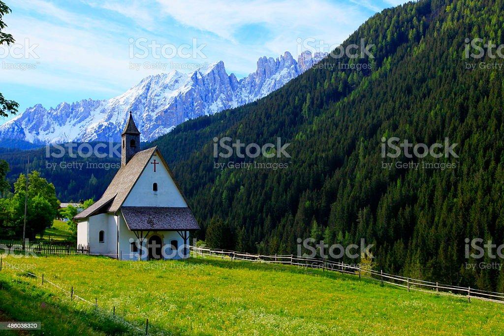 Alpine Church chapel in Dolomites, Italian tirol alps stock photo