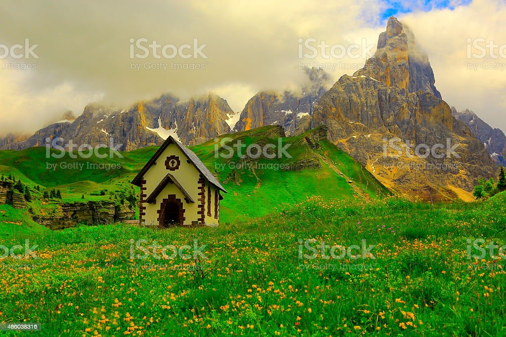 Alpine church chapel in Dolomites - Rolle Mountain pass stock photo