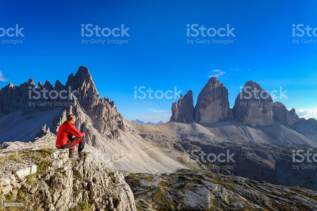 Alpine climber look to Three pinnacles, European Alps stock photo