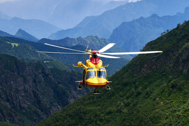 Alpine helicopter rescue stock photo