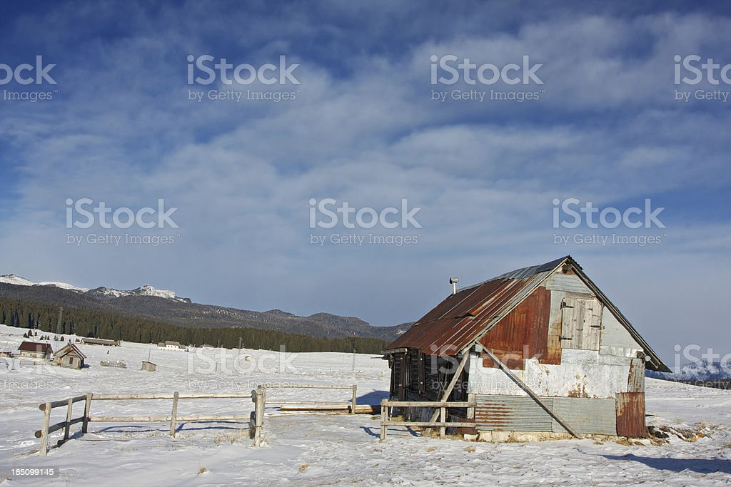Alpine hut in the winter at sunrise royalty-free stock photo