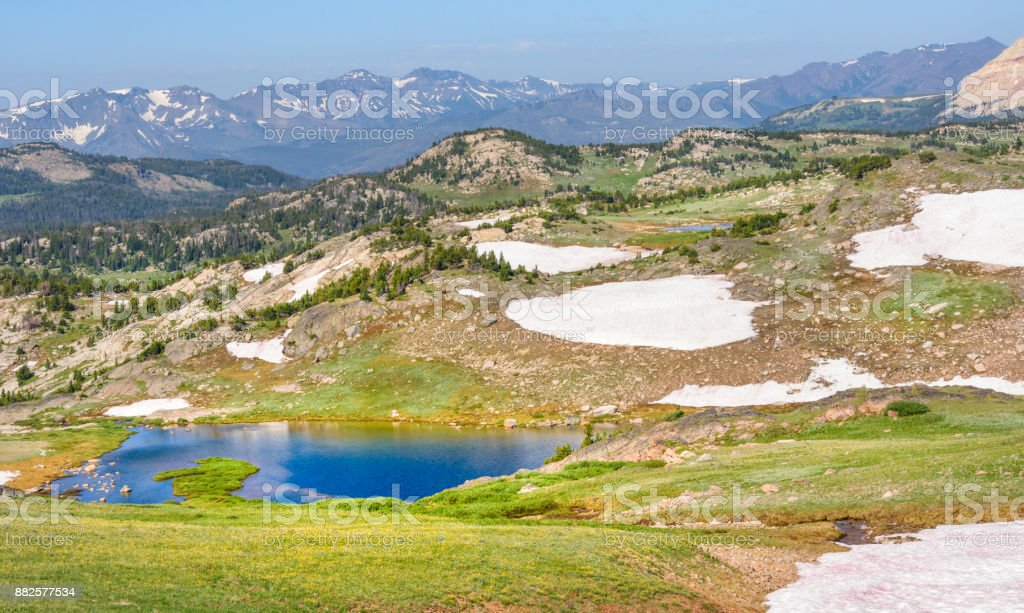 Alpine lake along the Beartooth Highway. Yellowstone Park, Peaks of Beartooth Mountains, Shoshone National Forest, Wyoming, USA. stock photo