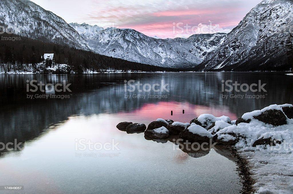 Alpine lake Bohinj at sunset royalty-free stock photo