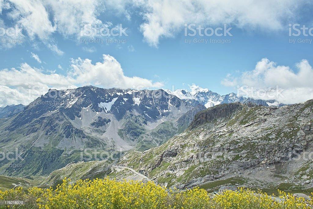alpine landscape wiht Ecrins mountain road to Col du Galibier stock photo