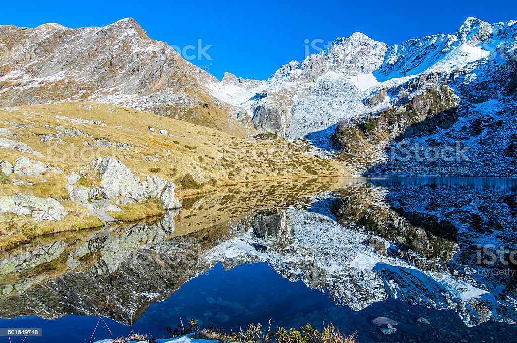 Alpine landscape with lake stock photo