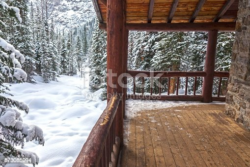 Alpine Teahouse Log Cabin Porch and Snowy Forest Background on Plain of Six Glaciers Banff National Park Canadian Rockies