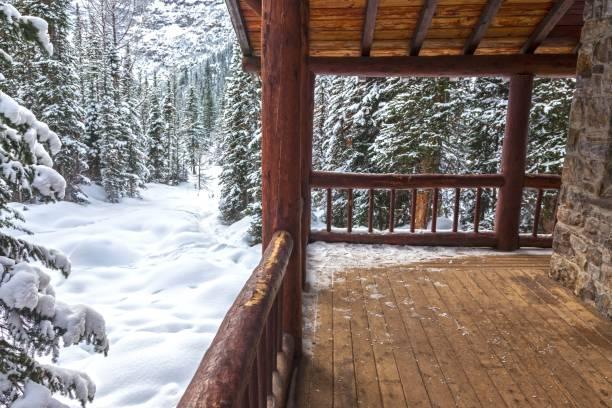 Alpine Log Cabin Porch in Winter in Banff National Park stock photo
