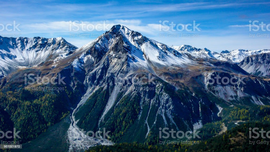 alpine mountain landscape in the late fall with the first snows covering the summit alpine mountain landscape in the late fall with the first snows covering the summit in the Swiss national park near Zernez Adventure Stock Photo
