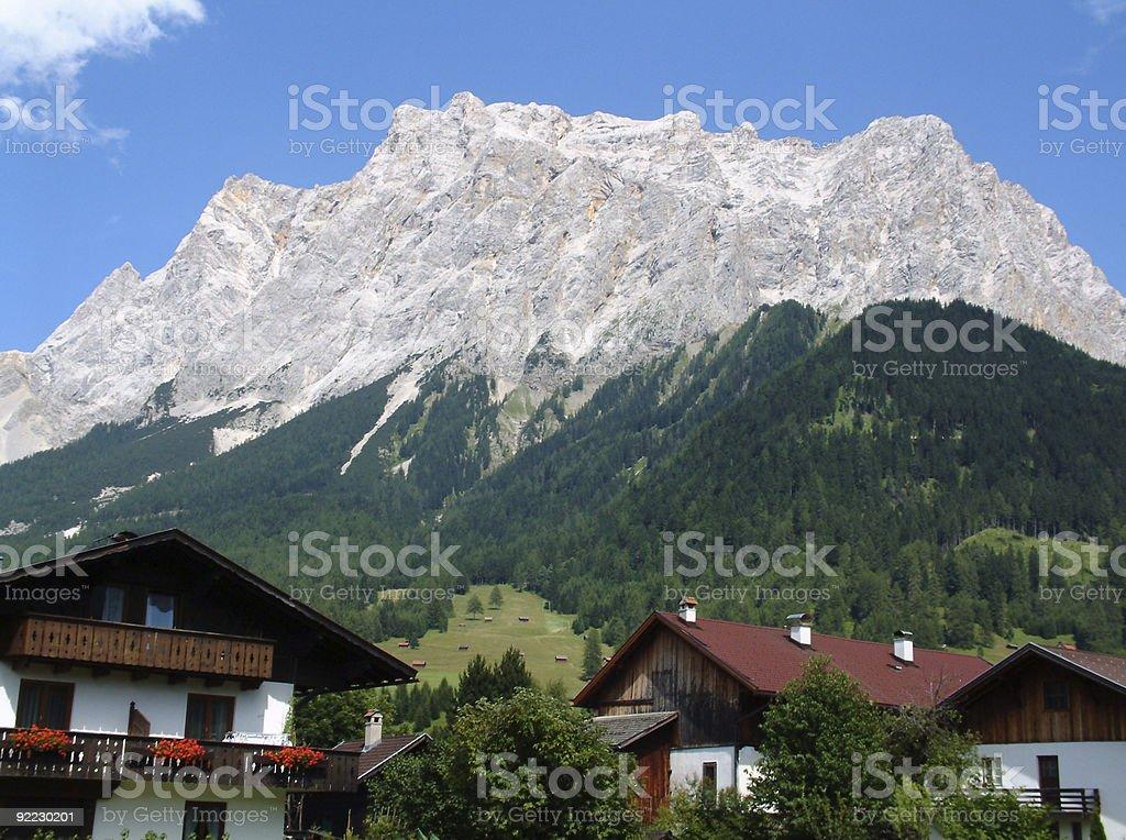 Alpine Mountain range and Chalets royalty-free stock photo