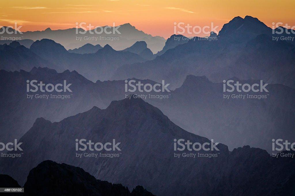 Alpine Mountain Silhouettes at Sunrise stock photo