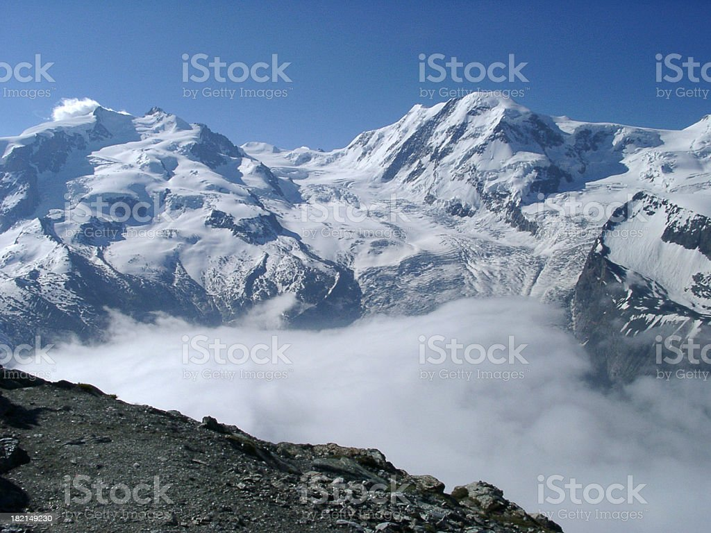 Alpine mountain view early morning with clouds in the valley royalty-free stock photo