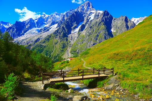 Alpine paradise! Mont Blanc landscape meadow, bridge, trail, Aosta