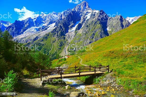 Photo of Alpine paradise! Mont Blanc landscape meadow, bridge, trail, Aosta